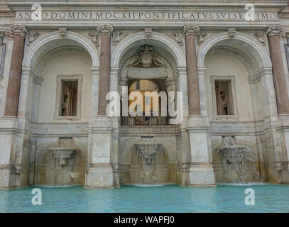 Rome, Lazio, Italy - September 10, 2017: Front view of a fountain in Rome with three arches and water at the bottom - Stock Photo