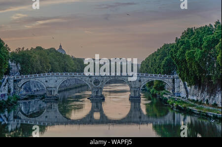 Rome, Lazio, Italy - September 12, 2017: View of Ponte Sisto with reflection in the Tiber river in the evening of Rome - Stock Photo