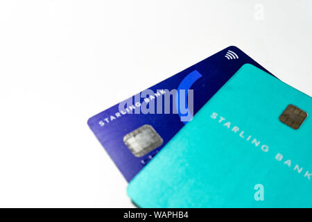 Credit cards emitted by the new digital bank Starling Bank on white background - Stock Photo