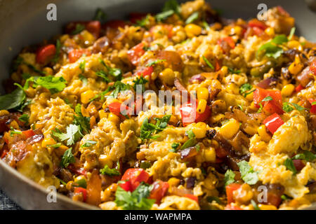 Homemade Organic Southwestern Egg Scramble with Toast - Stock Photo