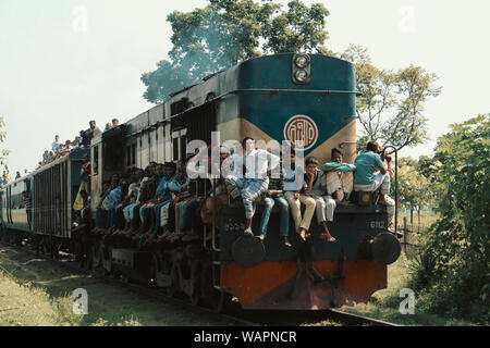 Chapai Nawabganj, Bangladesh, 2017. An over crowded train is passing by from an rural station to another. - Stock Photo