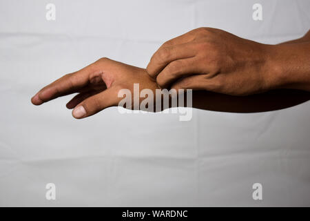 Close up Asian man scratch the itch with hand isolated on white background - Stock Photo