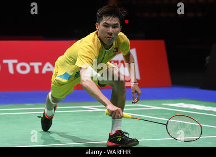 Basel, Switzerland. 21st Aug, 2019. Lee Cheuk Yiu of China's Hong Kong competes during the men's singles second round match against Chen Long of China at the BWF World Championships 2019 in Basel, Switzerland, Aug. 21, 2019. Credit: Li Jundong/Xinhua/Alamy Live News - Stock Photo