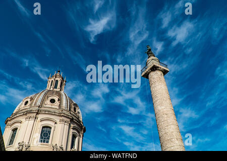 Trajan's Column (Colonna Traiana) in Rome, Italy and Chiesa del Santissimo Nome di Maria - Stock Photo