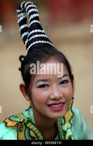 Young beautiful woman at a Buddhist novice hood initiation ceremony in Bagan, Myanmar. - Stock Photo