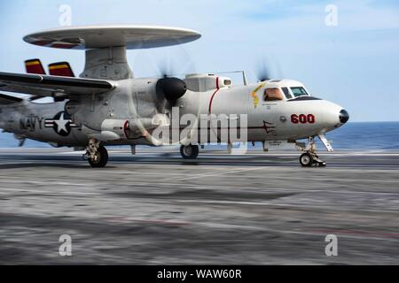 190817-N-CL027-2301 PHILIPPINE SEA (August 17, 2019) An E-2D Hawkeye from Airborne Early Warning Squadron (VAW) 125 lands on the flight deck of the Navy's forward-deployed aircraft carrier USS Ronald Reagan (CVN 76) during flight operations. Ronald Reagan, the flagship of Carrier Strike Group 5, provides a combat-ready force that protects and defends the collective maritime interests of its allies and partners in the Indo-Pacific region. (U.S. Navy photo by Mass Communication Specialist 2nd Class Janweb B. Lagazo) - Stock Photo