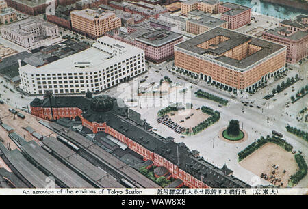 [ 1930s Japan - Tokyo Station ] —   Areal view of Tokyo Station, located in the Marunouchi business district of Tokyo, near the Imperial Palace grounds and the Ginza commercial district. The building was designed by architect Tatsuno Kingo to celebrate Japan's victory in the Russo-Japanese War.   The station opened on December 20,  1914. In 1921, Prime Minister Takashi Hara was assassinated here.  20th century vintage postcard. - Stock Photo