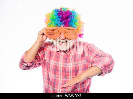 Nice joke. Grandpa always fun. Elderly clown. Man senior bearded cheerful person wear colorful wig and sunglasses. Having fun. Funny lifestyle. Fun and entertainment. Comic grandfather concept. - Stock Photo
