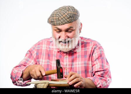 retro man repair shoes with hammer. shoemaker working with leather textile and hammer at workshop. shoemaker at work. Cobbler workmanship. mature shoemaker make shoes. Working on trending designs. - Stock Photo