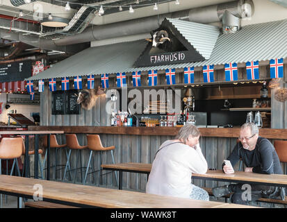 Street food stalls at the Grandi Matholl Food Hall in the old harbour district of Reykjavik, Iceland - Stock Photo