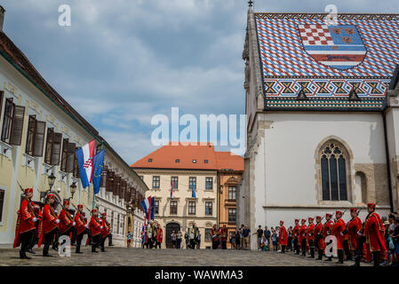 The Changing of the Guard, Croatian soldiers in historical regalia in ceremonial parade at St Mark's Square, Zagreb, Croatia - Stock Photo