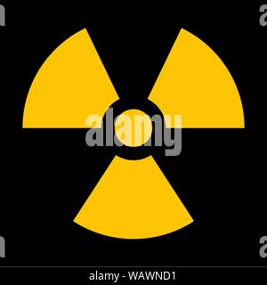 Yellow radiation sign isolated on dark background - Stock Photo