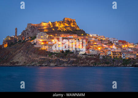 Colorful houses on the hillside with a fortress on the top. Night panorama of medieval town Castelsardo, Sardinia, Italy. Beautiful, calm evening. Pop - Stock Photo