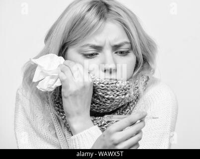 Seasonal flu concept. Woman feels badly. How to bring fever down. Fever symptoms and causes. Sick girl with fever. Girl sick hold thermometer and tissue. Measure temperature. Break fever remedies. - Stock Photo