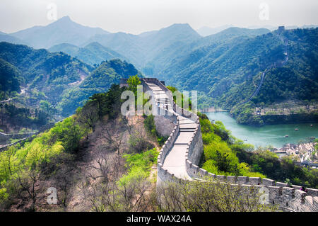 The great wall of china at the Huanghua cheng scenic area  in the west of Beijing china on a sunny summer day leading down to the water. - Stock Photo