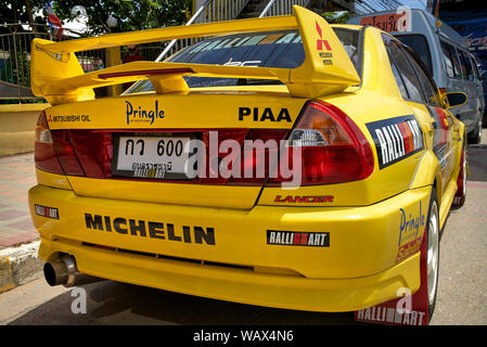 Mitsubishi Lancer yellow car. Race prepared modified sports saloon - Stock Photo