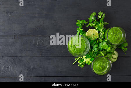 Detox diet concept. Green smoothie on a wooden background top view - Stock Photo