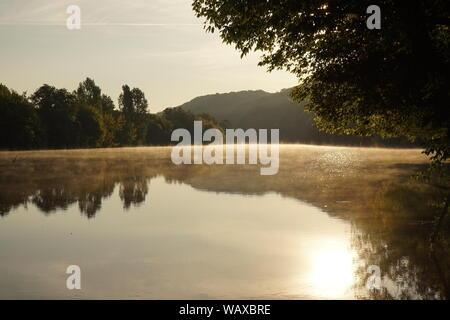 Sunrise and morning mist over the Dordogne river - Stock Photo