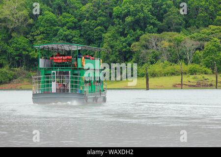 A boat cruise on Periyar Lake in Periyar National Park and Wildlife Sanctuary, Thekkady, Kerala, India - Stock Photo