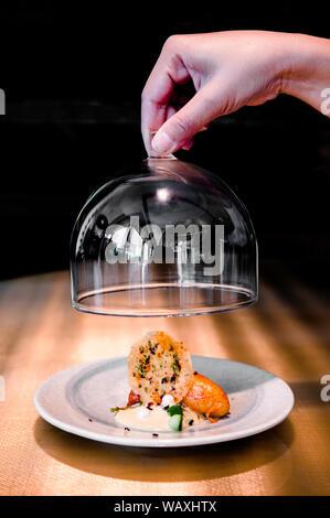 Lobster Ravioli with Hokkaido sea urchin foam and baby spinach. - Stock Photo