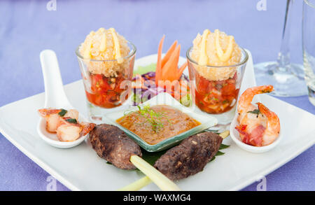 Beef Satay skewer appetizer canape and peanut sauce - Stock Photo