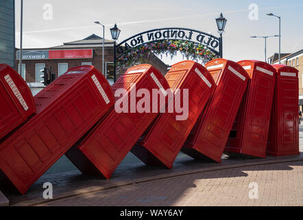 12 telephone boxes toppled over like dominoes is symbolic of Kingston Upon Thames, Surrey. Out of Order, by David Mach, arrived in 1989. - Stock Photo