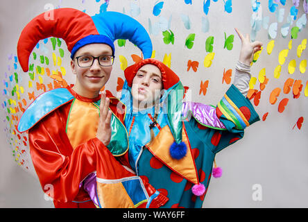 Kharkiv, Ukraine, April 8, 2019: Young child is dressed up in a clown costume for carnival - Stock Photo
