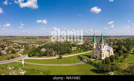 Summer landscape, countryside. Aerial drone view of old church and traditional Ukrainian village. - Stock Photo