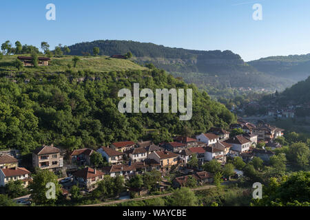 View to Trapezitsa fortress hill and old town in banks of River Yantra, Veliko Tarnovo in Bulgaria. - Stock Photo