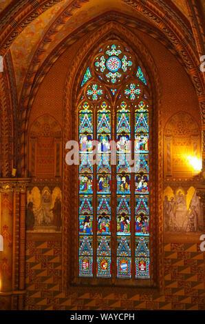 Budapest, Hungary - May 19, 2010:  Stained glass window in Roman Catholic Matthias Church. Budapest, Hungary - Stock Photo