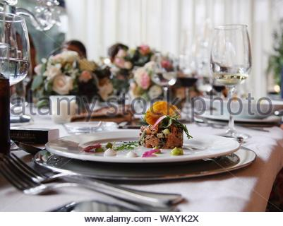 Raw meat on white ceramic plate - Stock Photo