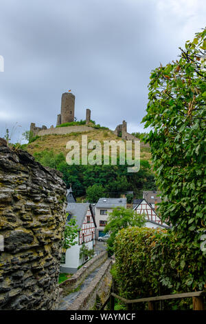 The beautiful and picturesque village of Monreal with the Lowenburg castle in the background in the Eifel region, Germany - Stock Photo