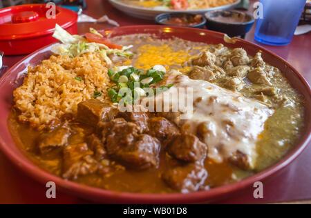 Authentic Mexican chimichanga pork burrito with sour cream jalapeno and cilantro - Stock Photo