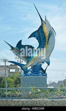 swordfish marlin fish pez vela sculpture on the street in a town by the beach outside a restaurant bar hotel - Stock Photo