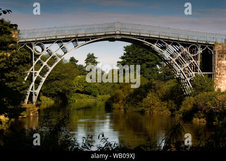 Upstream view from south bank of river Severn in the Ironbridge Gorge, England on a Summer morning. - Stock Photo