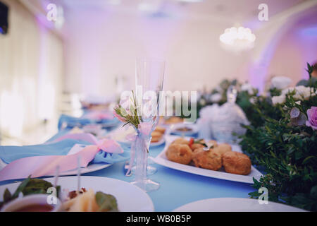 In the restaurant at the wedding table a lot of different meals - Stock Photo