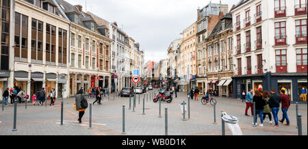 Panoramic view of shopping and sightseeing people along the Rue Esquermoise and Place du General de Gaulle with shops. Lille, France. - Stock Photo