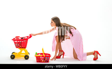 shopping girl with full cart. home delivery. retro woman go shopping. vintage housewife woman. savings on purchases woman going to make payment in - Stock Photo