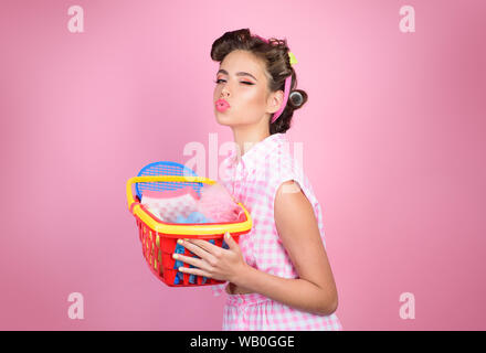 online shopping app. savings on purchases. vintage housewife woman ready to pay in supermarket. happy girl enjoying online shopping. retro woman go - Stock Photo