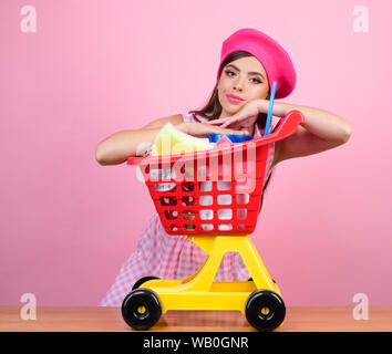 retro parisian woman go shopping with full cart. vintage housewife woman ready to pay in supermarket. savings on purchases. happy girl enjoying online - Stock Photo