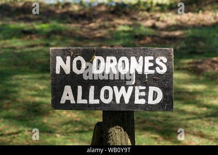 A wooden No Drones Allowed warning sign, lake Naivasha, Kenya - Stock Photo
