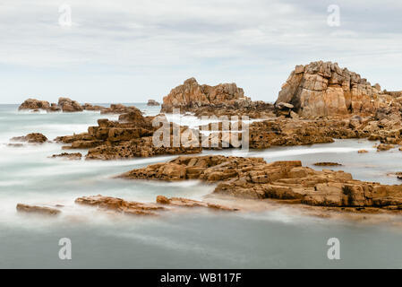 Scenic view of rock formation against sky in pink granite coast, Gouffre, Brittany, France. Long exposure - Stock Photo