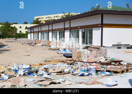 City street and mountains of garbage after construction. - Stock Photo