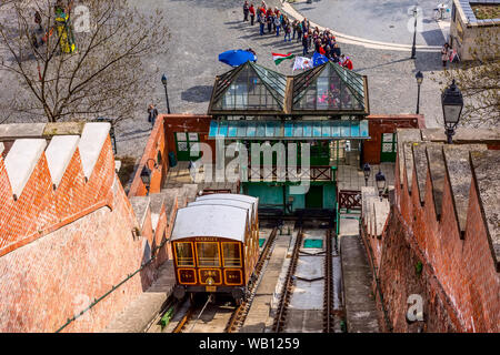 Budapest, Hungary - March 29, 2015: Street view with cable car cabin going to the hill Gellert - Stock Photo