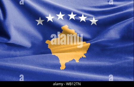 Realistic flag of Kosovo on the wavy surface of fabric - Stock Photo