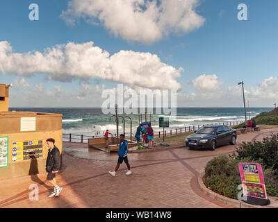 DURBAN, SOUTH AFRICA - AUGUST 14, 2019: People enjoying the sunny weather on the promenade at the beach in Umhlanga Rocks, near Durban, KwaZulu-Natal, - Stock Photo