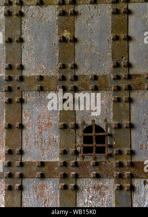 Medieval fortress Sant Elmo castle door in Naples, Italy. Detail of wooden and metal gate of big door leading to Saint Elmo Castle. - Stock Photo