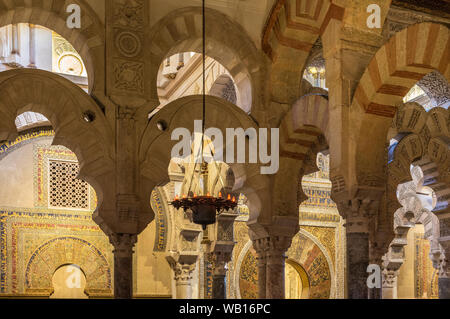 Pillars and multi-lobed arches in front of the mihrab. The Great Mosque, La Mezquita, Cordoba, Spain - Stock Photo