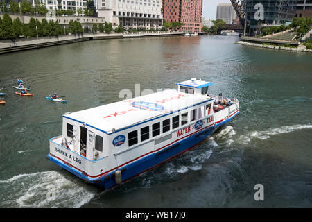 chicago water taxi passing Wolf Point on the chicago river downtown chicago illinois united states of america - Stock Photo