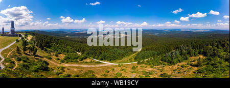 Germany, Hesse, Schmitten, Aerial view of Grosser Feldberg, aerial mast of hr and viewing tower, Oberreifenberg in the background - Stock Photo
